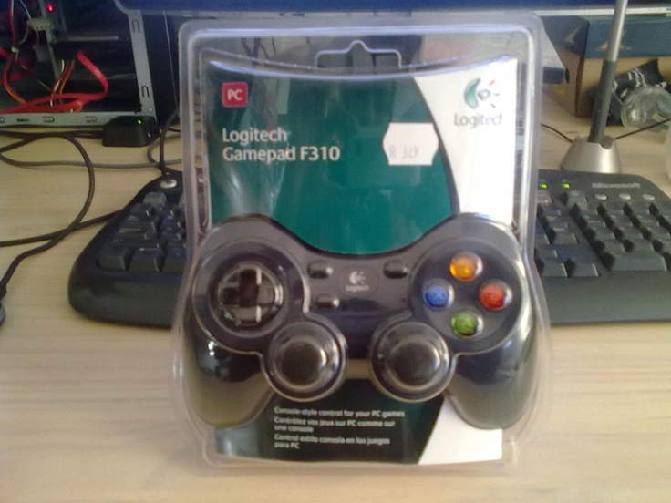 The Logitech F310 gamepad, still in it's packaging