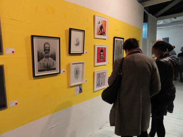 A couple of attendees check out Ben Winfield's and Peter Woodbridge's work