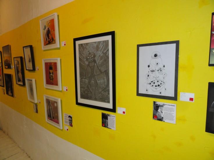 On the right, a piece by Ryan Carolisen